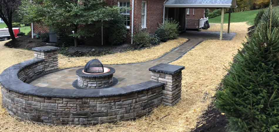 We built a small fire pit in this Canonsburg backyard, that features screening.