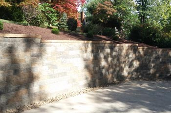 Recently constructed retaining wall to help control erosion at a home in McMurray, PA.